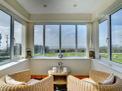 Photo for Snowdonia farm cottage with panoramic sea views from all rooms, including the sun room and the cosy