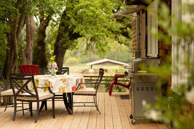 Cottage deck with grill, old oaks and horses in the pastures below
