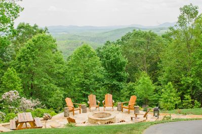 Firepit and picnic area in the summer time