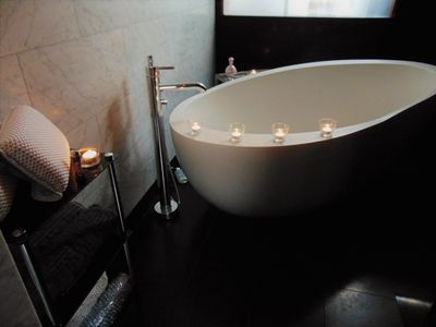 Private bathroom with super soaker tub, mud mask treatments & mineral salts