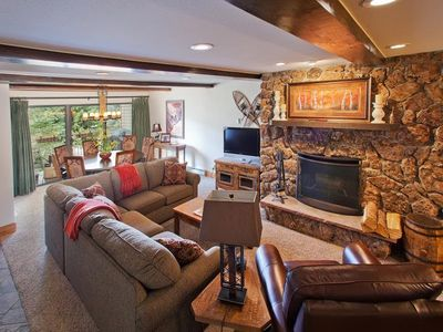 Beautiful living room with wood burning fireplace.