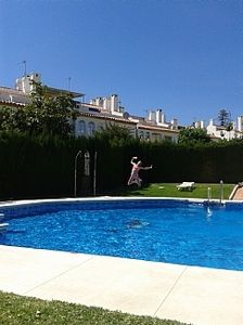 Photo for 4 Bedroom Townhouse With Pool Close To Town, Beach And Park - Free WiFi