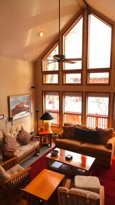 Looking from our Office Loft into our Family Room with cathedral windows.