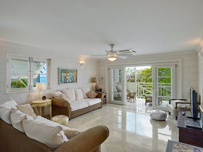 Photo for A luxury beach front apartment with pool in Paynes Bay, St James.From £1500pw