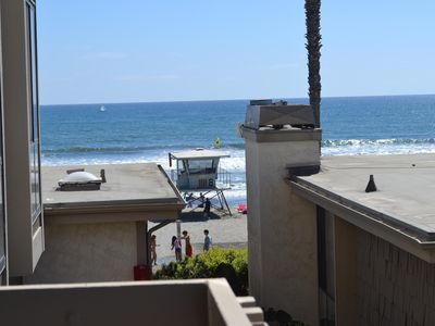 Photo for One of the closest units to the beach!! Watch and listen to the crashing waves.