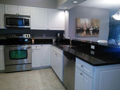 fully stocked newly renovated kitchen  overlooks updated living area