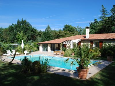 Photo for COZY VILLA WITH SWIMMING POOL ON GOLF, 15 MIN FROM BORDEAUX