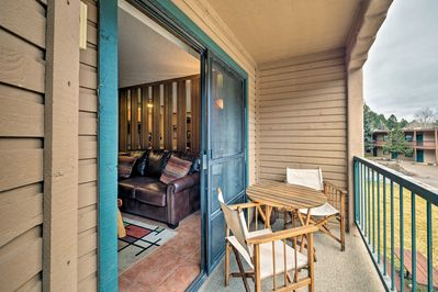 The condo features a furnished balcony in a tranquil community.