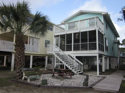 Perfect ocean view location with large screened-in porch and upper large sundeck