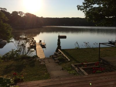 View of the lake and the dock from the side deck.