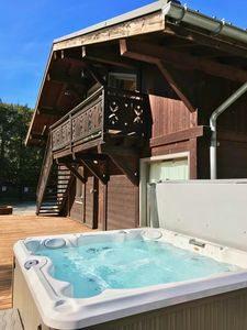 Photo for Chalet apartment with stove and private jacuzzi