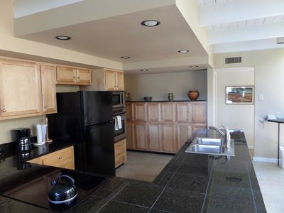 Kitchen with cooktop, microwave, oven, k-cup coffee machine, dishwasher