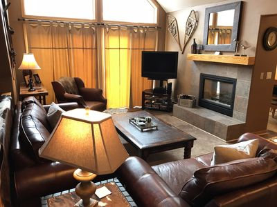 Great room, leather furniture, vaulted ceiling, gas fireplace & patio deck doors