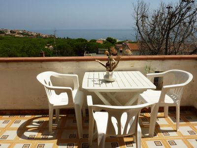 Photo for Apartment overlooking the sea and the bay at 10 'walk from the beach