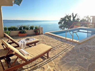 Photo for This 2-bedroom villa for up to 6 guests is located in Omis and has a private swimming pool, air-cond