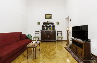 Sitting Room: Sofa-Bed, Flat Screen TV, Sideboard, Books and Paintings