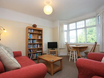Photo for BOURNECOAST: FIRST FLOOR APARTMENT WITH LAWN GARDEN - DOG FRIENDLY - FM667