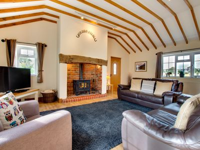Photo for This beautifully renovated cottage offers exposed beams and stonework along with a wood fire creatin