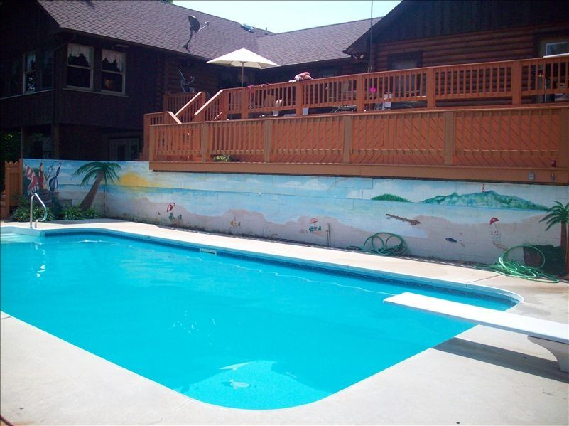 Inground 16 X 35 Swimming Pool Surrounded By Beautiful 3 Tier Deck With Grill