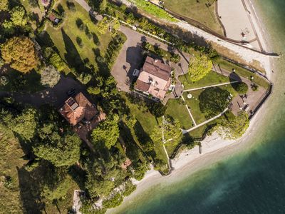 Photo for Two wonderful lakefront villas with private beach and wide park