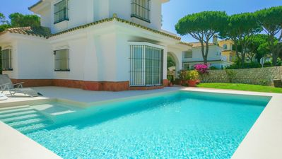 Photo for Double story villa 50m from the beach with pool