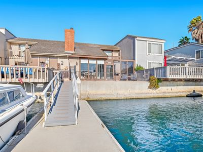 Photo for Unique & sleek dog-friendly two-level home w/water views, pool table & dock