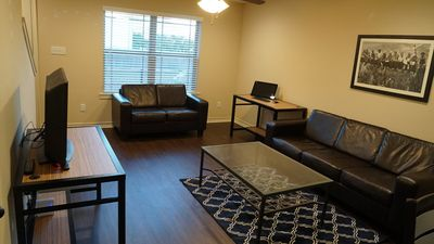 Photo for Like  New Condo! 1 mile to TAMU, Century Square, & across from Carney's Pub