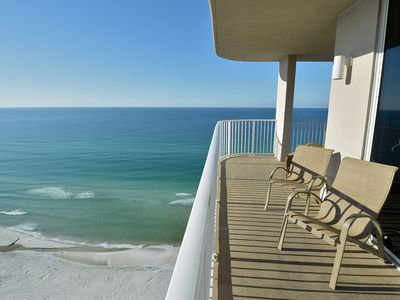 Photo for Panoramic end unit, wrap around balcony, floor to ceiling windows, on the beach!