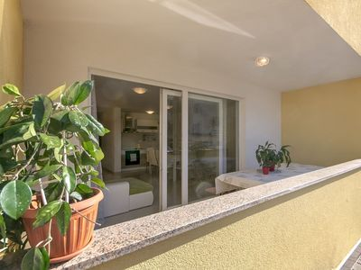 Photo for Catered apartment with spacious terrace and sandy beach just steps away