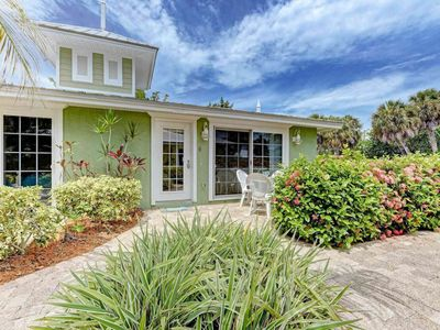 Photo for Stylish dog-friendly seaside cottage with a shared pool and community Tiki hut!