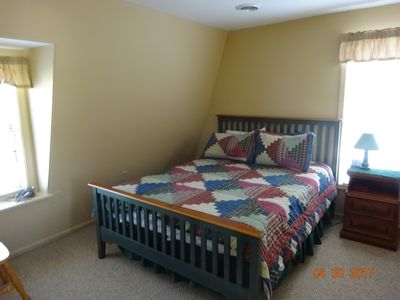 Larger bedroom with queen bed.