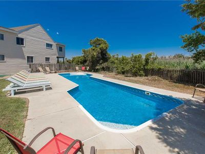 Photo for Bayfront dog friendly home with private dock & pool, amazing sunsets, short walk to the beach