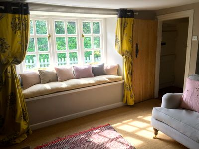 Sitting room with sunny window seat.  Open plan with dining area.