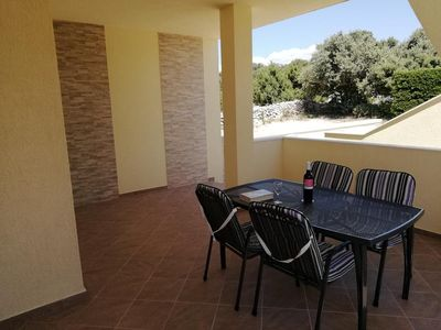 Photo for Two bedroom apartment with terrace and sea view Mandre (Pag)