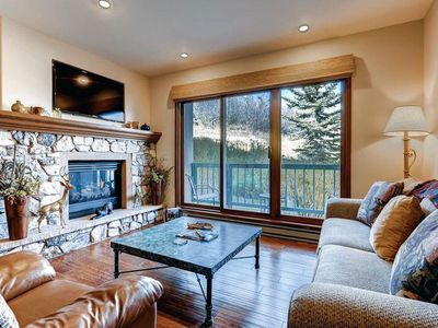 Photo for Relax on the private balcony of this ski-in/ski-out condo w/shared pool & hot tub
