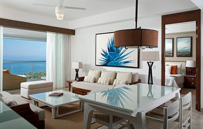 Dining and Living area of the Grand Bliss Master Suite with view of the deck.