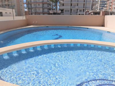 Photo for CAPRI 2º - PLAYA GANDIA, FRONT VIEW, POOL (RENTAL ONLY FAMILIES)