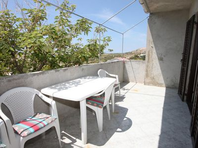 Photo for Two bedroom apartment with terrace and sea view Zubovići, Pag (A-6409-a)