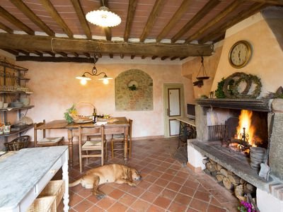 Photo for Stone Rustico with garden in an ancient village in Tuscany. View on ancient Pieve