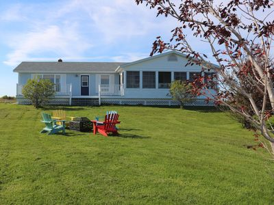 Photo for Beautiful, private south shore summer home - walk to the beach.