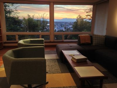 Living Room - Take in incredible sunset views through large windows in the living room.