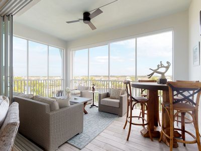 Photo for NEW LISTING! Modern luxurious condo with great bay view and shared pool