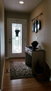 Bright foyer with storage table for keys and sunscreen