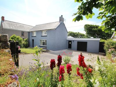 Photo for This charming property sits in the heart of Middleton, a quiet village close to Rhossili with its aw