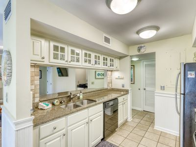 Photo for Waterfront family retreat with pond views - close to tennis and golf! Dogs okay!