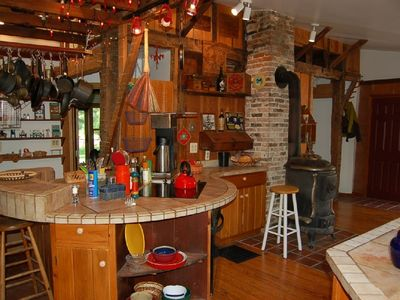 Farmhouse kitchen with lotsa pots, large Bunn coffee maker.