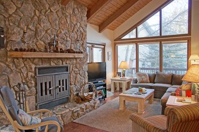 Vaulted ceilings and large windows in this spacious living room