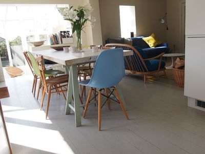 Open plan dining area from kitchen and into living room