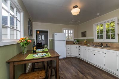 The kitchen is spacious, open and adjoins the dining room.