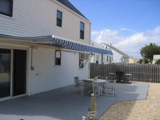 Back yard Salt water pool Bar/shed Retractable awning